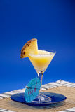 Pina Colada Smoothie. A refreshing summer drunk - pina colada over a blue background royalty free stock image
