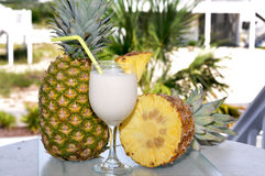 Pina Colada on Table with Pineapple Half Royalty Free Stock Photos
