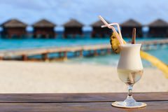 Pina colada on tropical beach Stock Photo