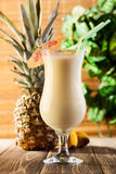 Pina Colada on wooden background garnished pineapple Stock Photography