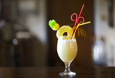 Pina Colada. Yellow alcohol cocktail with pineapple, lemon, cold vodka filled with crushed ice in a beautiful cocktails glass royalty free stock images