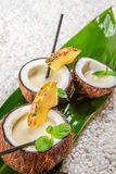Pinacolada in a coconut Stock Images