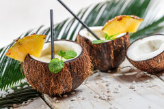 Pinacolada in the coconut with pineapple Stock Photos