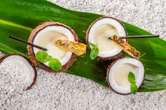 Pinacolada drink with fresh mint leaves served in coconut Stock Images