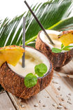 Pinacolada drink with mint served in a fresh coconut Royalty Free Stock Photos