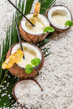 Pinacolada drink served in a coconut on the beach Stock Images