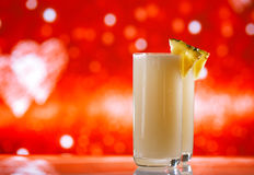Pinacolada pina colada cocktail glitter red golden backdrop Royalty Free Stock Photo
