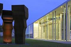 Pinakothek der Moderne in Munich, Bavaria. Art by Eduardo Chillida, Buscando la Luz, in front of the Pinakothek der Moderne museum at evening, Munich, Bavaria Royalty Free Stock Images