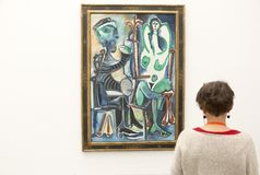 Aritst and model Picasso painting in Pinakothek der Moderne  in Munich. Pinakothek of the Modern is a modern art museum, situated in central Munich`s Kunstareal Royalty Free Stock Image