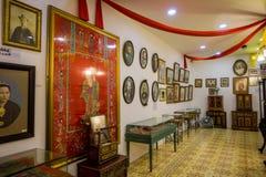Pinang Peranakan Mansion, a museum containing antiques and showcasing Peranakans customs, interior design and lifestyles. Portraits in Pinang Peranakan Mansion Stock Photo