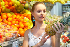 Pinapple. Brunette beauty while shopping Royalty Free Stock Photography