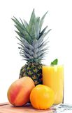 Pinapple, mango, and orange Stock Photos