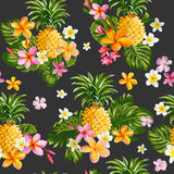 Pinapples and Tropical Flowers Background Stock Image
