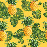 Pinapples and Tropical Leaves Background Stock Images