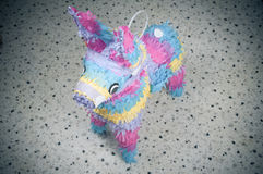 Pinata. Colorful donkey mexican party pinata over blurred backgound Royalty Free Stock Photography
