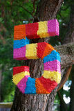 Pinata as numbers of five. For child birth Royalty Free Stock Photography