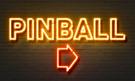 Pinball neon sign on brick wall background. Stock Photography