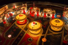 Pinball table close up view of vintage game machine.  Royalty Free Stock Photography