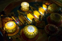 Pinball table close up view of vintage game machine.  Royalty Free Stock Photo