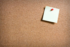 Pinboard with notes on it. Yellow memo stick on cork board background Stock Images
