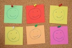 Pinboard smileys. Lots of feelgood smileys on the pinboard Royalty Free Stock Image