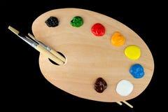 Pincéis e cores na pálete Imagens de Stock Royalty Free