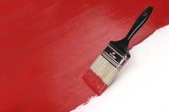 Pinceau avec la peinture rouge Image libre de droits