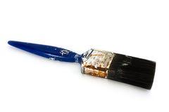 Pinceau bleu utilisé modifié au-dessus de blanc Photographie stock libre de droits