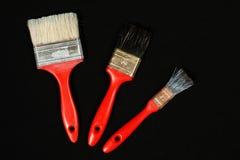 Pinceau de trois rouges Image libre de droits