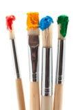 Pinceau quatre avec la couleur Photos stock