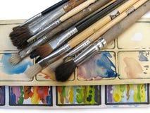 Pinceaux et palette Photo stock