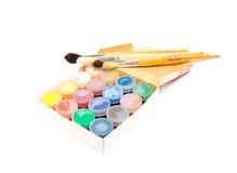 Pinceaux et teinture Photographie stock