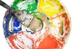 Pincel na paleta da cor Fotos de Stock