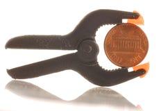 pincement de penny Photographie stock libre de droits