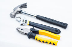 Pincer pliers claw hammer and wrench Stock Photos