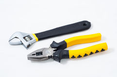 Pincer pliers and wrench. On white background Royalty Free Stock Images