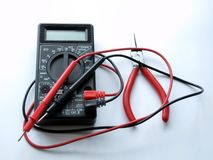 Pincers and multimeter. Repairing tools: electronics at home or vehicles electronics Royalty Free Stock Photography