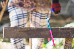 Pincers. Placed on a hanging rod. A construction worker was walking back to pick  in a blurred background Stock Photo