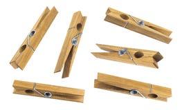 Pinces à linge en bois d'isolement sur le fond blanc Photo libre de droits