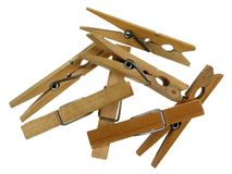 Pinces à linge en bois sur le fond blanc Photos libres de droits