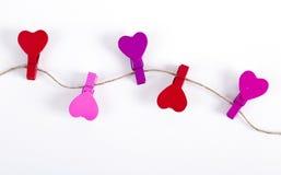 Pinces à linge en bois sur une corde Photo libre de droits