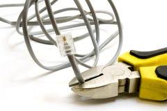 Pinces de combinaison avec le câble de réseau images stock