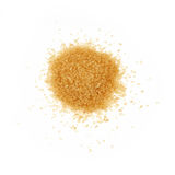 Pinch of brown cane sugar spilled on white Stock Images