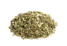 Pinch of Oregano. A Pinch or Tablespoon of Oregano Herb piled up against a white background Stock Images