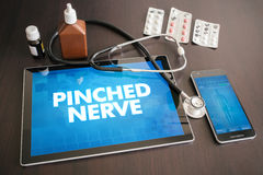 Pinched nerve (neurological disorder) diagnosis medical concept. On tablet screen with stethoscope stock images