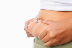Pinching fat on tummy Stock Images