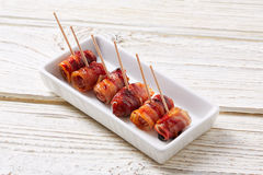 Pinchos Bacon wrapped dates pintxos tapas Stock Image