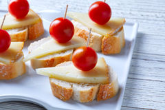 Pinchos manchego cheese cherry tomatoes Royalty Free Stock Photo