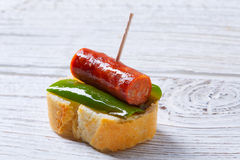 Pinchos pintxos chistorra with pepper tapas Stock Photography