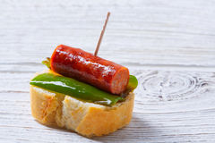 Pinchos pintxos chistorra with pepper tapas Royalty Free Stock Images